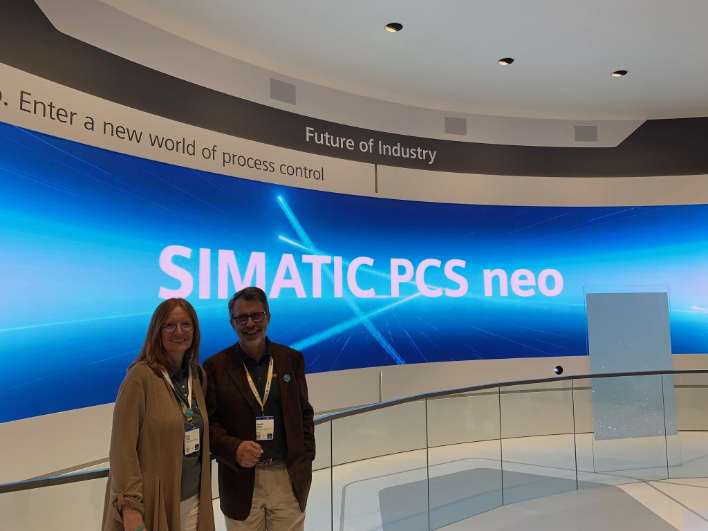 Karen and Harry Pigler with Simatic PCS neo sign